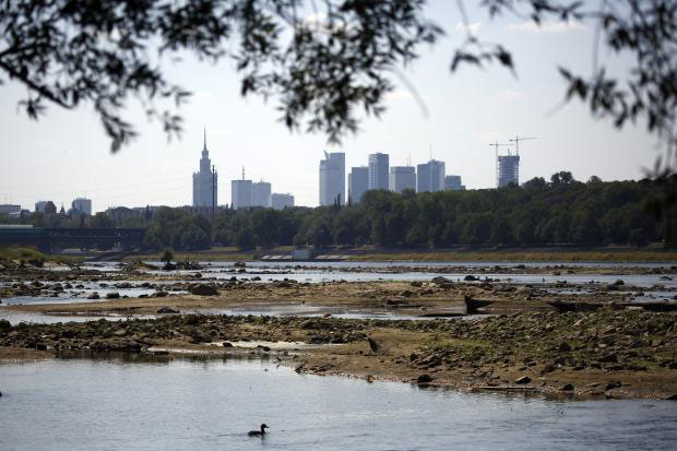 The dried Vistula riverbank is seen in Warsaw, Poland, on August 19. Poland's longest river hit its lowest water level in more than 200 years because of a drought ravaging the country, a weather official said. Photo Credit: KACPER PEMPEL/REUTERS.