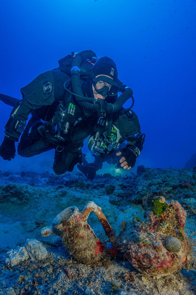 Archaeologists excavating the famous ancient Greek shipwreck that yielded the Antikythera mechanism have recovered more than 50 items including an intact amphora; a large lead salvage ring; two lead anchor stocks (possibly indicating the ship's bow); fragments of lead hull sheathing; and a small and finely formed lagynos (or table jug). (Photo by Brett Seymour, EUA/ARGO)