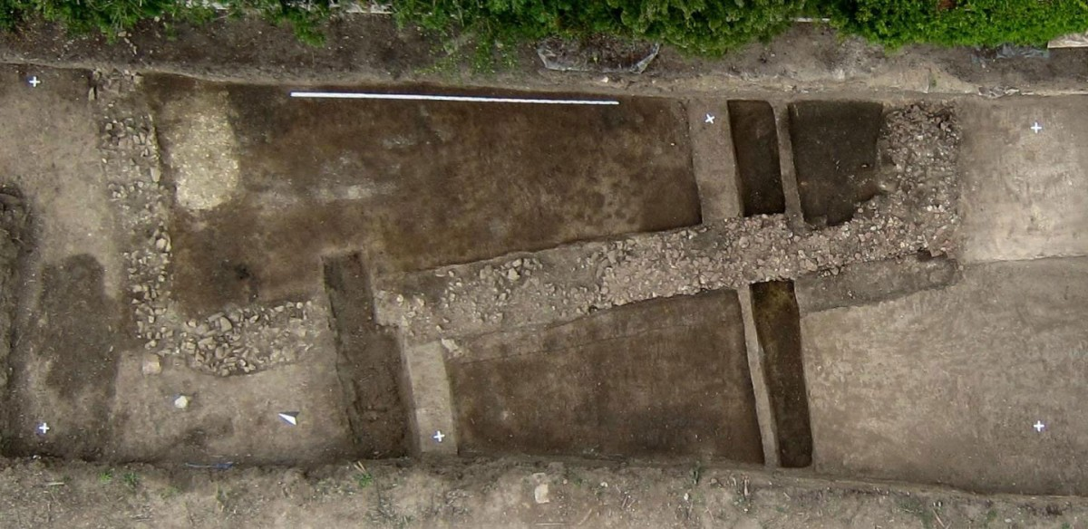 Aerial image of the foundation of a Roman stone building. Length of the leveling staff (White) at the upper edge of the Picture: 5 meters. Credit: Dennis Braks.