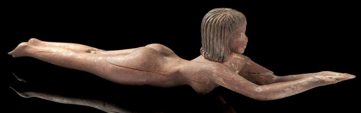 Old Kingdom wooden statuette, possibly representing a cosmetic tool. (Photo: Egyptian Ministry of Antiquities)
