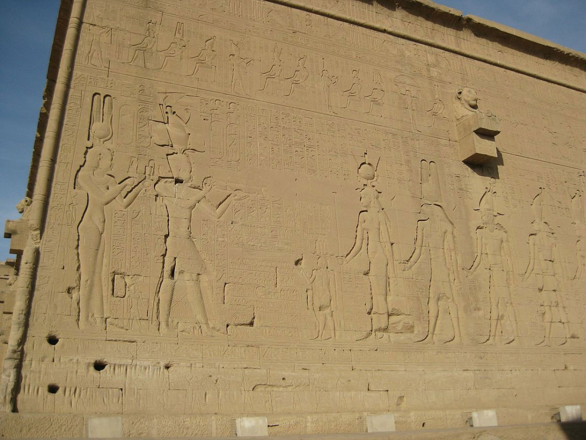 The temple of Hathor. Reliefs on the south (rear) wall. Ptolemy XV Caesar and Cleopatra VII before Harsomtus, Isis, and other deities. Temple of Hathor - Dendera.