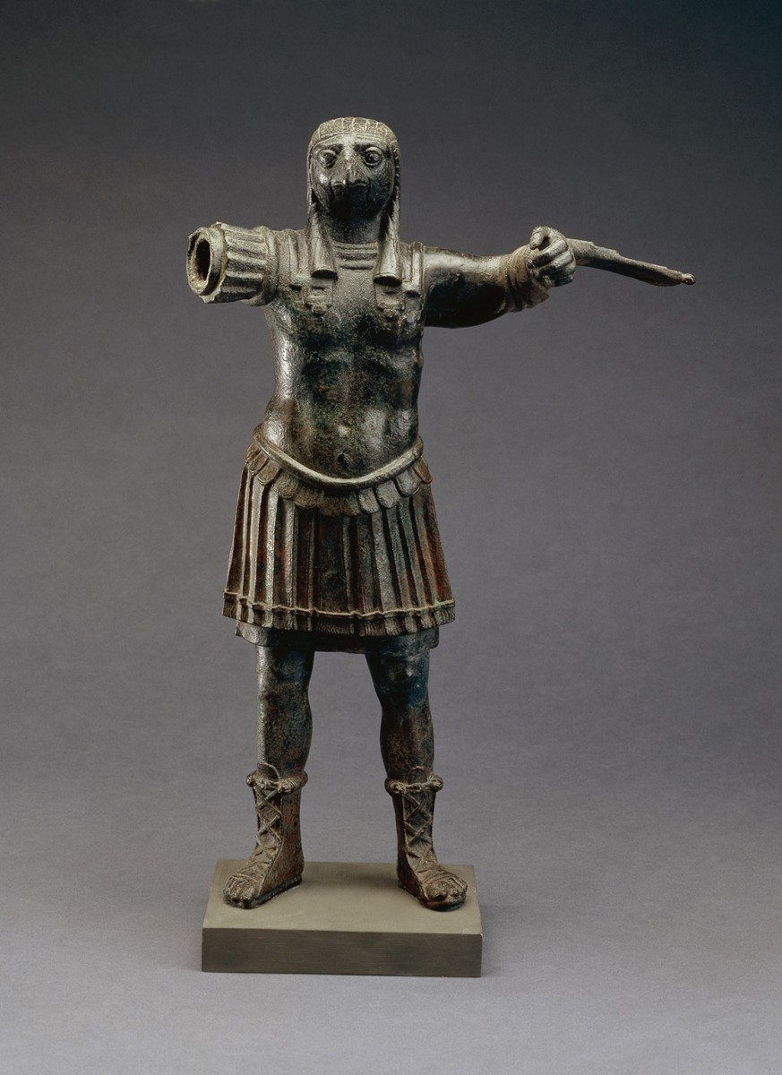 Bronze figure of the ancient Egyptian falcon god Horus in Roman armour (EA 36062).  ©The Trustees of the British Museum.