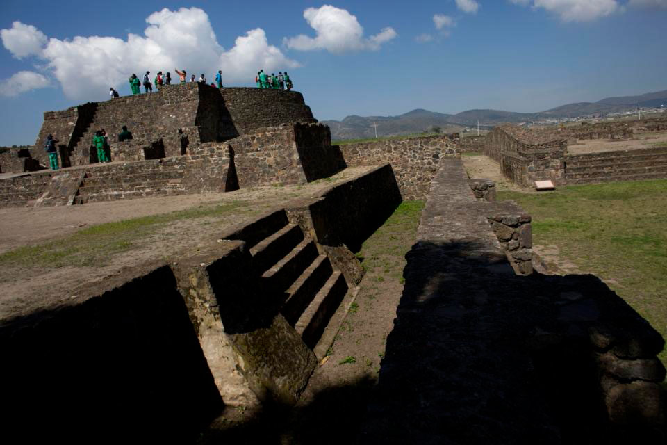 Students stand on a temple at the Zultepec-Tecoaque archaeological site in Tlaxcala state,  Mexico Thursday. New excavations here, the site of one of the Spanish  conquistadors' worst defeats in Mexico, are yielding new evidence about what  happened when two cultures clashed, and the native Mexicans,  at least temporarily, were in control. Photo Credit: AP/Rebecca Blackwell.
