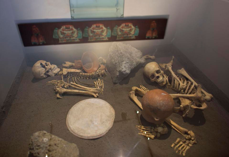 The skeletons of sacrificed Spaniards are displayed inside a glass case at the museum  of the Zultepec-Tecoaque archaeological site in Tlaxcala state, Mexico. Photo Credit: AP/Rebecca Blackwell.
