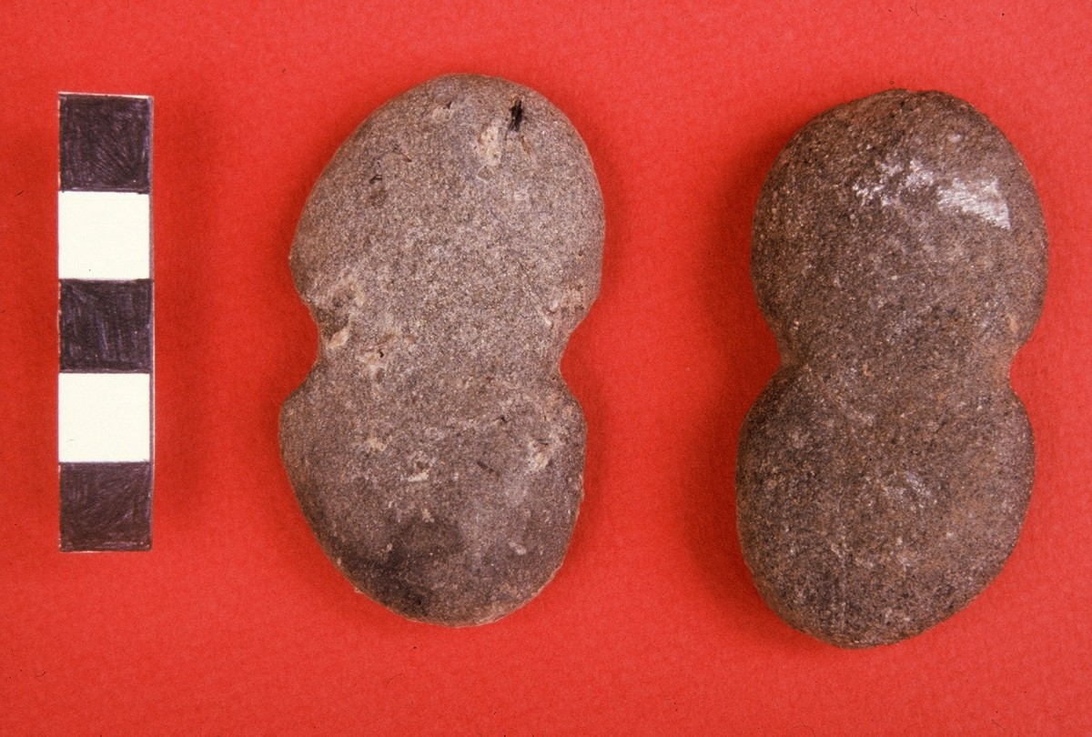 Fig. 27. Eight-shaped stone weights, probably for weaving or fishing.