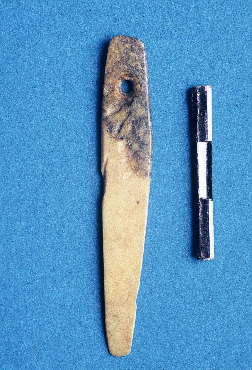 Fig. 29. Bone needle with eye, shaped from an animal's rib.