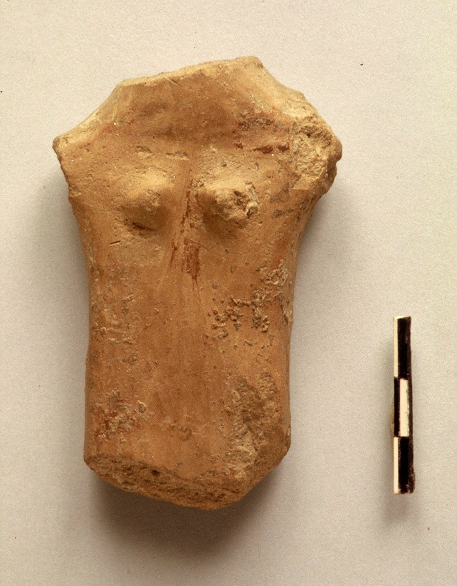 Fig. 37. Plank figurine with sculpted breasts and faded written decoration. Chalcolithic period.
