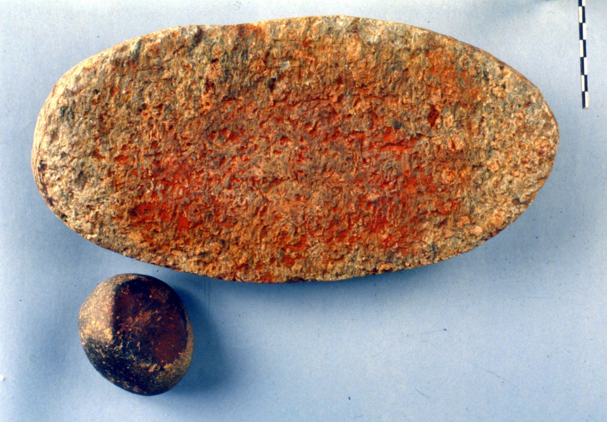 Fig. 45. Intact millstone with traces of red. The pestle has similar traces of colour.