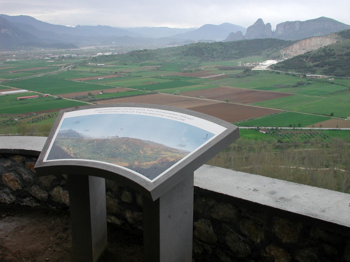 Fig. 5. Information board outside the cave gives information about the environment in the Palaeolithic period, before later interventions. Meteora and the Pineios river can be seen in the distance.