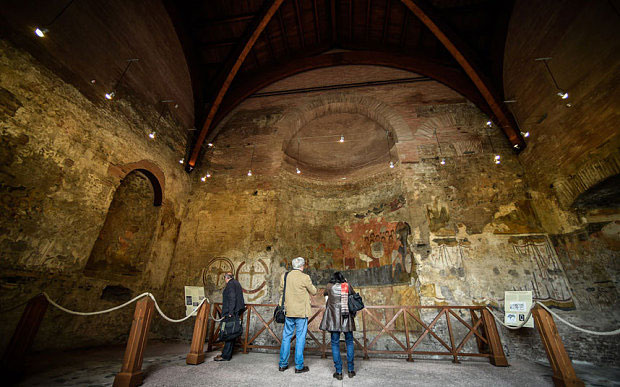 People look at frescos of the 'Oratory of the 40 martyrs' near the newly restored part of the Imperial Ramp.  Photo Credit: AP.