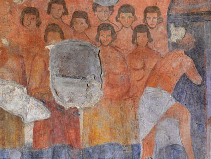 The walls are still decorated with frescoes of the