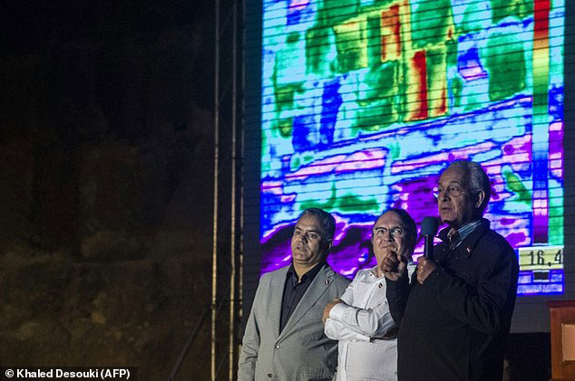 Thermal anomalies have been found in the pyramids of Giza. Egyptian Minister of Antiquities Mamdouh el-Damaty (left) spoke in front of the great pyramid of Khufu in Giza. A screen behind him showed an infrared thermography experiment to map out the temperature of the walls. Photo Credit: Khaled Desouki/AFP/Daily Mail.