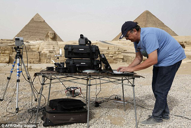 The hi-tech technique could mark a new era of discoveries. Here, an engineer sets up the infrared thermography equipment which is being used to map the temperature of the walls of the Giza pyramids. Photo Credit: AFP/Getty Images/Daily Mail.