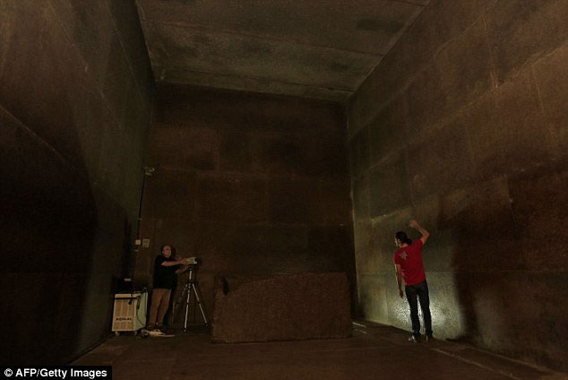 The Great Pyramid contains the most elaborate system of passages and chambers within any pyramid. Two chambers have been found, including the King's Chamber (pictured) but no body was found in the sarcophagus. Here, researchers use infrared thermography to map the walls of the chamber. Photo Credit: AFP/Getty Images/Daily Mail.