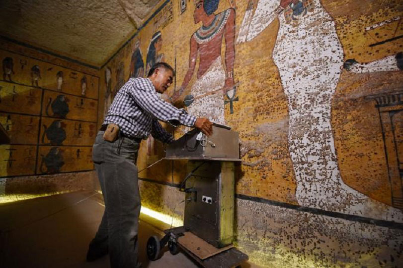 Hirokatsu Watanabe, a radar specialist from Japan, pushes his specially modified  Koden-brand machine along the north wall of Tutankhamun's burial chamber. Photo Credit: Brando Quilici/National Geographic.