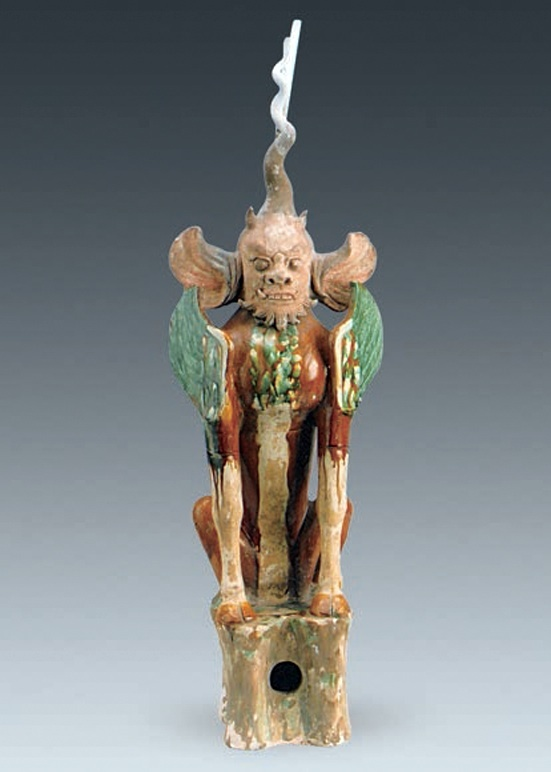 This figurine shows a tomb guardian with an angry human face. Tomb guardians were commonly used in ancient China and helped to protect the dead. It's about 92 centimetres in height. Photo Credit: Chinese Cultural Relics.