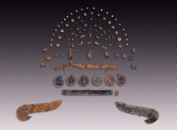 The remains of a headdress found in the tomb was found in about 300 pieces. Photo Credit: LiveScience.