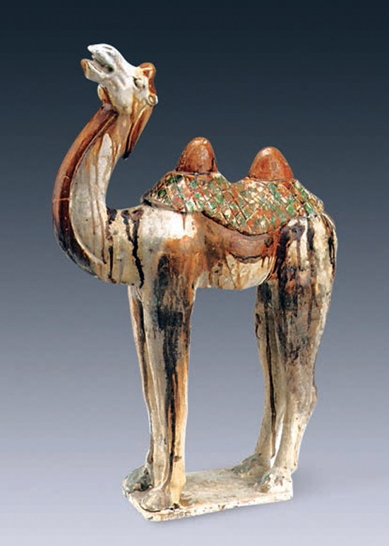 Some of the ceramic figurines found in the tomb depict animals. This colorful camel is about 65 centimetres in height. Photo Credit: Chinese Cultural Relics.