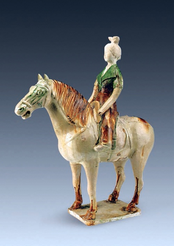 This image shows a female rider, wearing a short-sleeved jacket, on a horse. The figurine is about 41 centimetres  in height. Photo Credit: LiveScience.