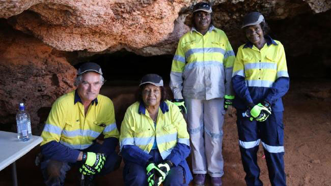 Peter Veth, left, with Thalanyi elders Anne Hayes, Roslyn Davison and Jane Hyland at Boodie Cave on Barrow Island. Photo Credit: Peter Veth/The Australian.