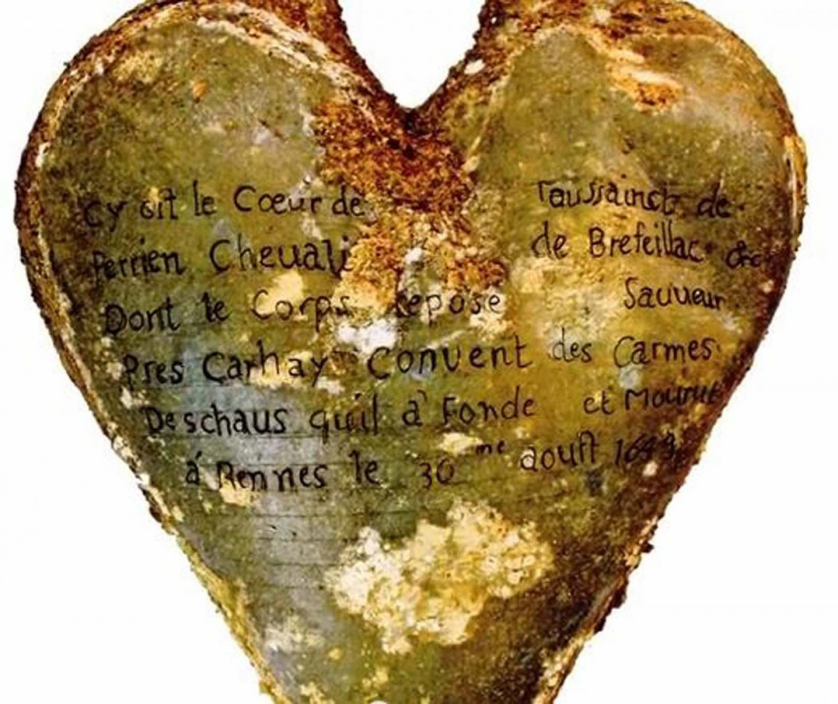 This is a heart-shaped lead urn with an inscription identifying the contents as the heart of Toussaint Perrien, Knight of Brefeillac. Credit: Image by Rozenn Colleter, Ph.D./INRAP