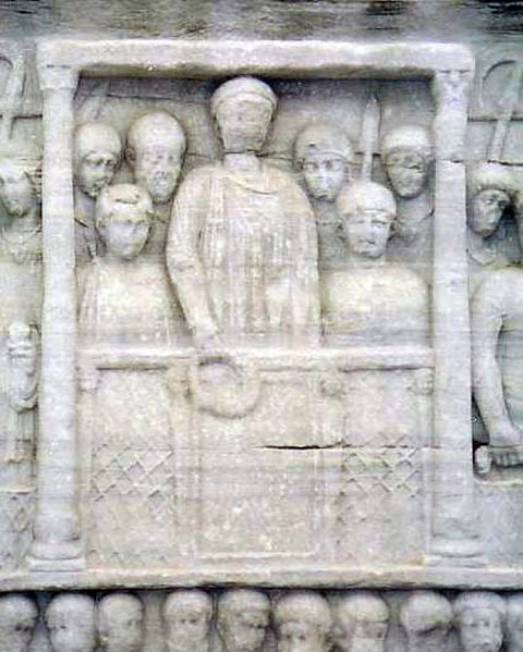 Fig. 3. Marble relief of emperor Theodosius holding a laurel wreath with members of his court, carved at the base of the obelisk at the Hippodrome of Constantinople.