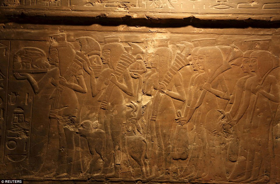 Carvings on the walls of the tomb's second room show Maya in front of several offering bearers, during the burial rites. Credit: Reuters
