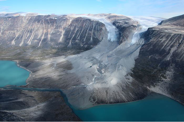 Glaciers usually advance during cold times and recede during warm ones. These two in western Greenland are now retreating from where they may have been when the Vikings arrived. Photo Credit: Jason Briner.