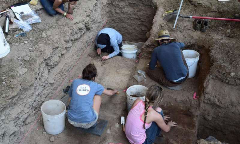 University of Wyoming students excavate a prehistoric rock shelter in the Big Horn Mountains of northern Wyoming during the summer of 2015. Hearths excavated at sites such as this provided many of the radiocarbon dates for new research showing that hunter-gatherers in the region that is now Wyoming and Colorado grew at the same rate as farming societies in Europe. Credit: UW Photo