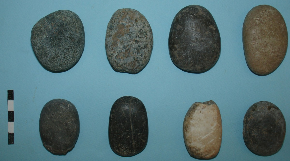 Fig. 8. Stone tools without a cutting edge, with one surface smoothed through use.