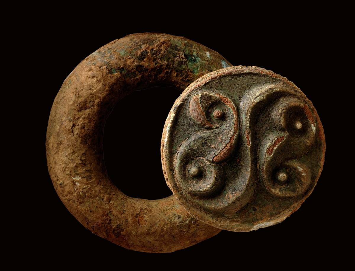 East Anglian Fens: Late Iron Age baldric ring with La Tène style decoration, probably part of a shoulder belt for carrying a sword.