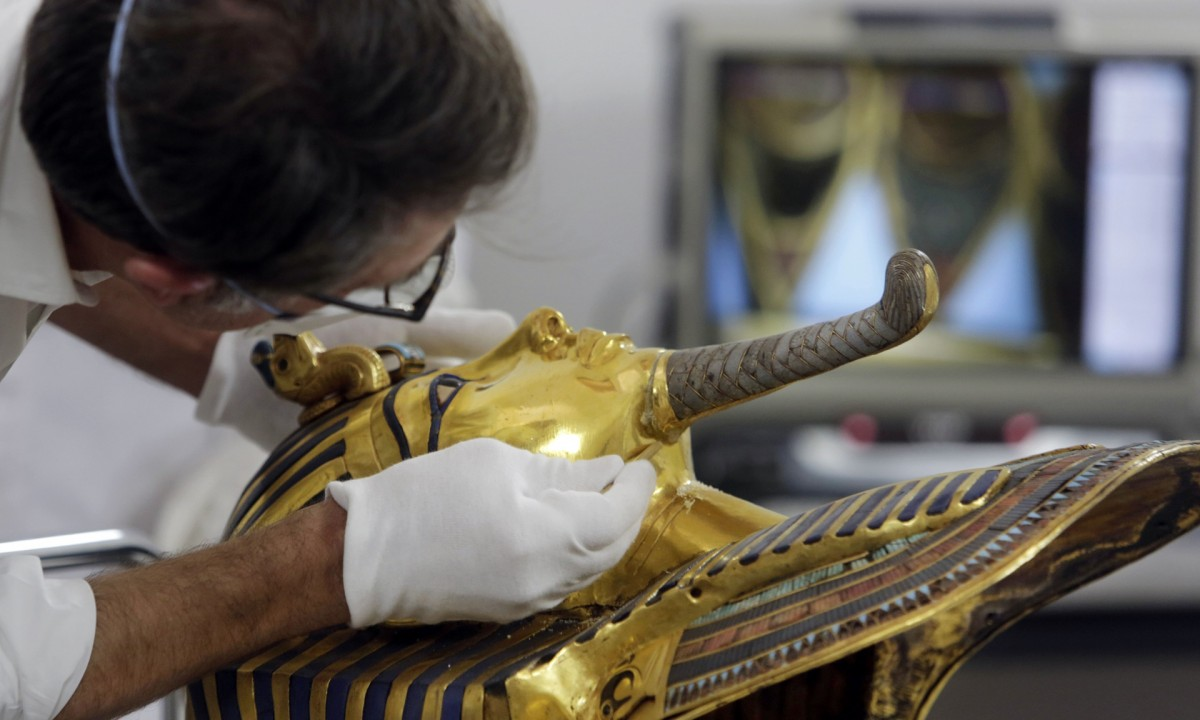 German conservator Christian Eckmann works on the restoration of the mask. (Photo credit: Amr Nabil/AP)