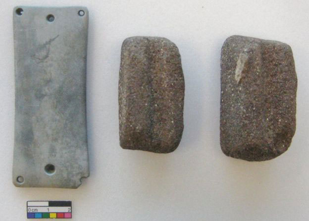 An archer's wrist guard and shaft straighteners were among the objects discovered. Photo Credit: Wiltshire Council CMAS/BBC.