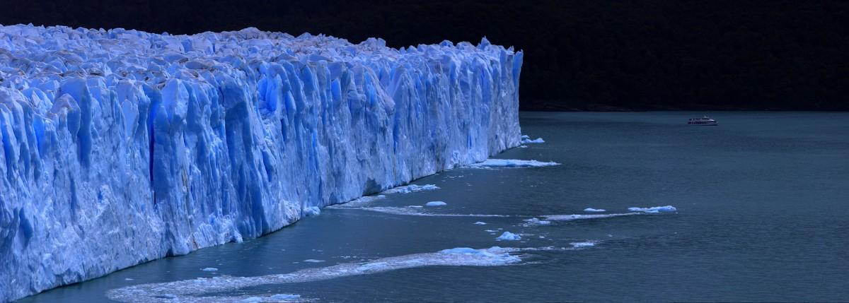 The Perito Moreno glacier forms a 60-metre (200 ft) high ice wall before falling into Lago Argentino. Photo credit: Martin St-Amant - Wikipedia - CC-BY-SA-3.0
