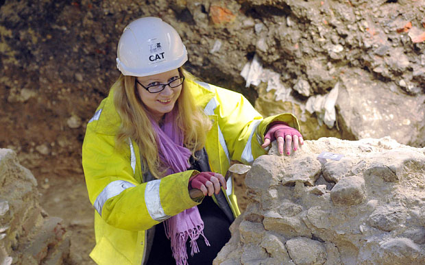 Emma Holloway, from Colchester Archeological Trust, works on the ruins. Photo Credit: The Telegraph.