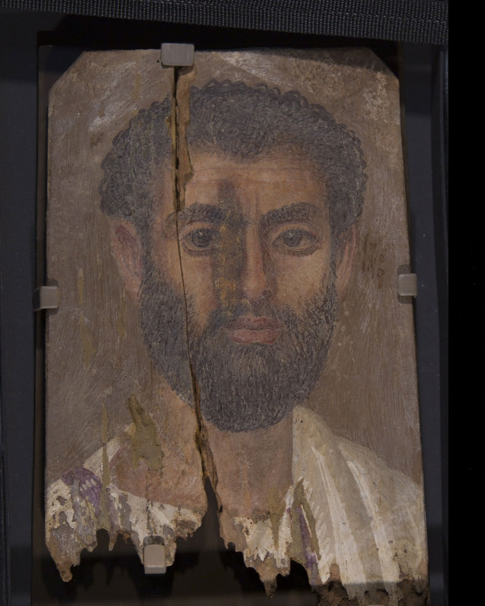 The well-preserved mummy portraits are extremely lifelike paintings of specific deceased individuals. They were excavated more than 100 years ago at the site of Tebtunis (now Umm el-Breigat) in the Fayum region of Egypt.