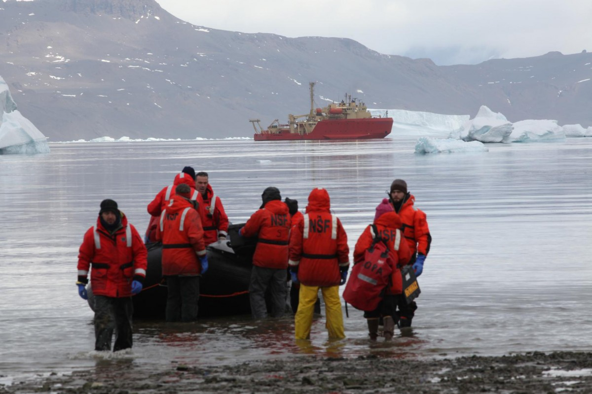 Researchers disembark on Antarctica during an expedition in 2011. AP3