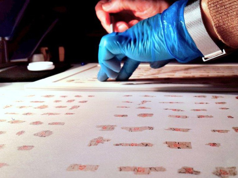 Thousands of the ancient scrolls fragments from the conservation table to the virtual table. Copyright: Shai Halevi, courtesy Israel Antiquities Authority