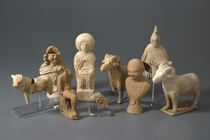 Ceramic figures found in a box on top of the coffin of a one-year-old Roman child.
