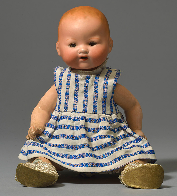 Modern doll with a ceramic face, hands and feet and a fabric body. Private Collection.