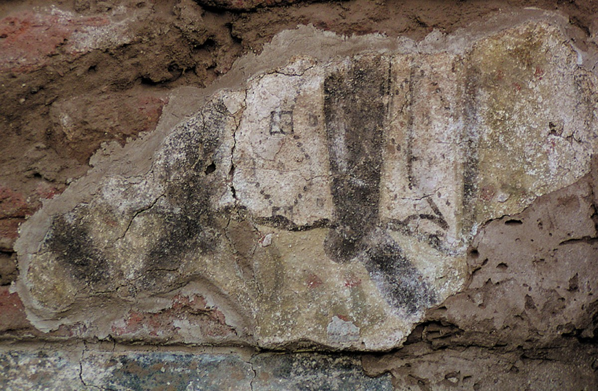 Fig. 1. Old Dongola, Cruciform Building; fragment of wall painting with warriors' legs on the north wall in the eastern arm of the building (phot. W. Godlewski) (Zielińska 2010a, fig. 5).