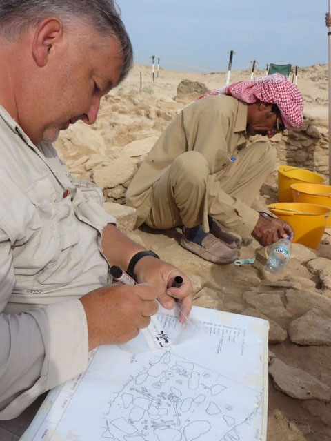 Project director Dr Mark Beech, makes notes as a colleague cleans and preserves finds at village MR II. Dr Beech said the dig shines light into life in the Western Region at the time of the Late Stone Age. Photo Credit: Abu Dhabi TCA/The National UAE.