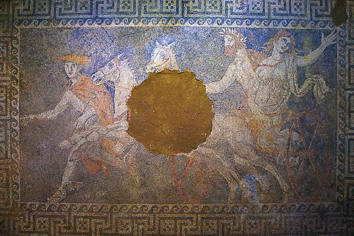 Fig. 10. Kidnapping of Kore, pebble mosaic in room 3 of the tumulus Kasta, in situ (photo of the author).