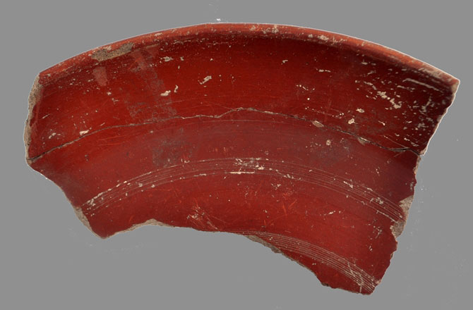One fragment of the non-stick frying pans with internal red-slip coating. Photo Credit: Marco Ciglio/Discovery News.