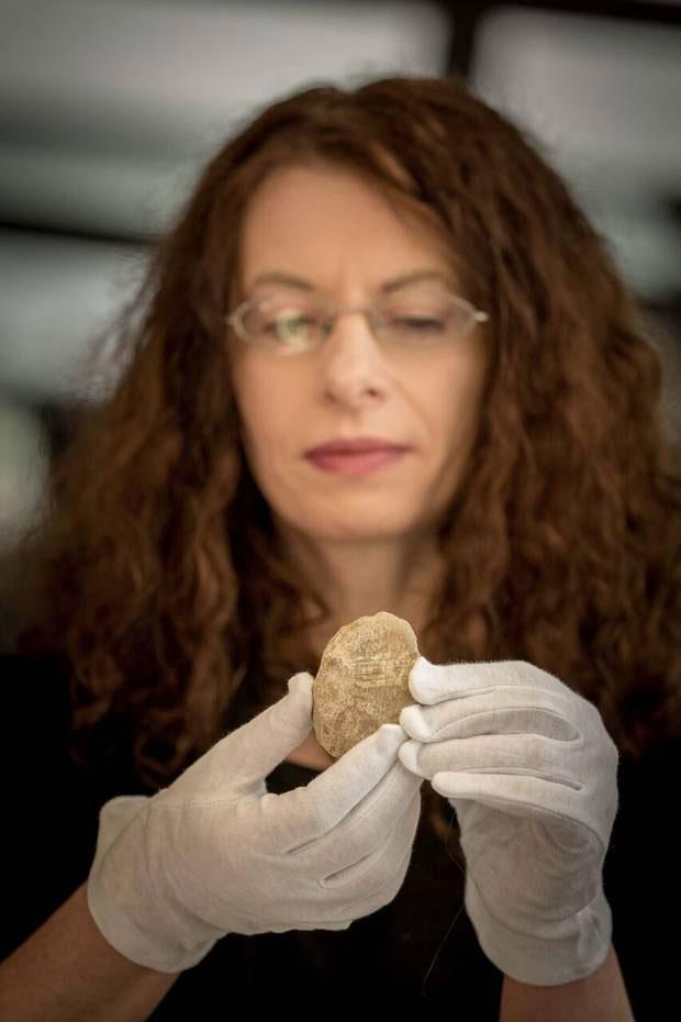 Dr Marion Dowd with the bear bone. Photo Credit: Storylab/Irish News.