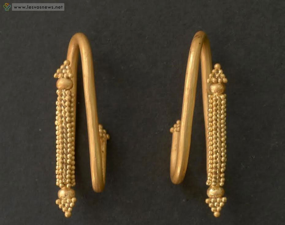 Gold earrings displaying granulation details.  From the Geometric tomb of Ippeios, Lesvos, Greece.