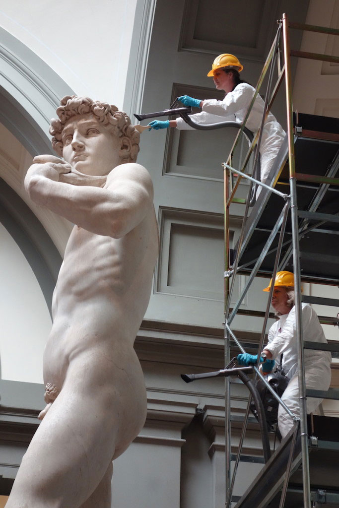 Armed with brushes and vacuum cleaners, experts cleaned the Italian Rennaissance masterpiece. Photo Credit: Artnet News.