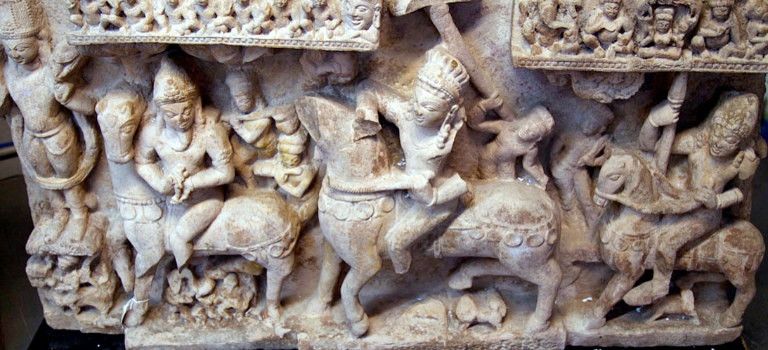 Buff sandstone panel depicting Revanta and His Entourage, from India, in the 8th century AD, approximately 30 by 53 inches, depicting a very rare representation of the equestrian deity, Revanta.