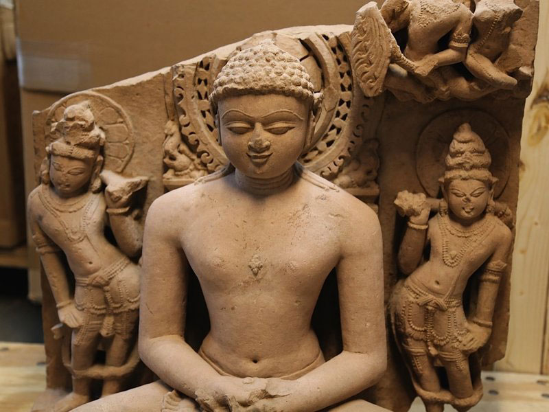 Sandstone statue of Rishabhanata, from Rajasthan or Madhya Pradesh, India, in the 10th century A.D., flanked by a pair of attendants. It is valued at approximately $150,000.