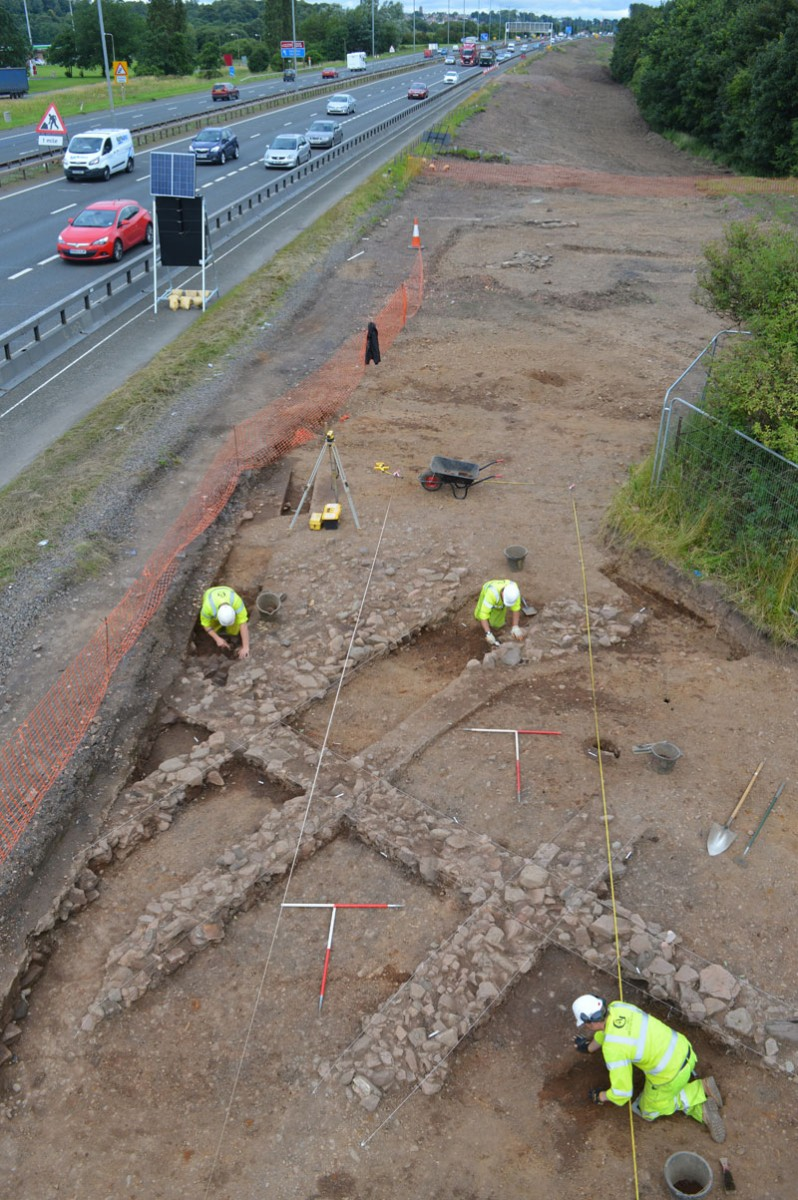 GUARD Archaeologists excavating the remains of a medieval building at Netherton Cross © GUARD Archaeology Ltd